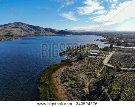 Aerial View Of Otay Lake Reservoir With Blue Sky And Mountain On The Background, Chula Vista, Califo