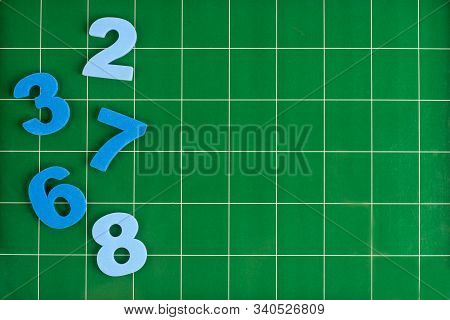 Different Numbers Lie On The Green Surface Of The Blackboard