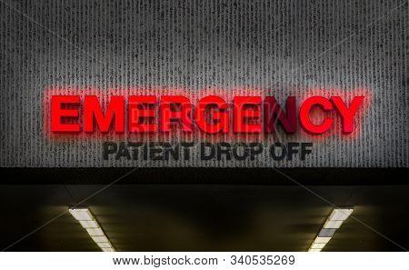 A Rundown Hospital Emergency Room Sign With Broken Light