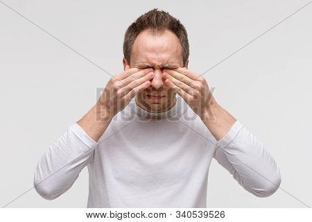 Close Up Of Man Has A Problem With Contact Lenses, Rubbing His Swollen Eyes Due To Pollen, Dust Alle
