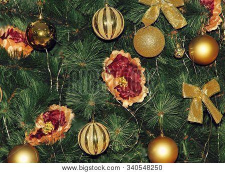 Christmas Fir-tree And Golden Christmas Decorations. New Year. Christmas.
