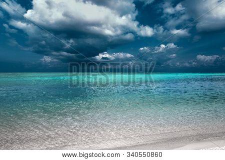 Tropical Island Beach View With Dark Blue Sky