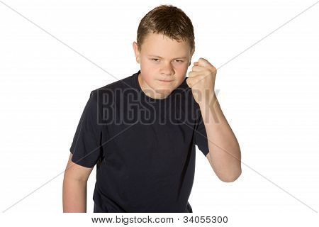 Angry casual young man in a black t-shirt with glaring eyes shaking his fist at the camera isolated on white poster