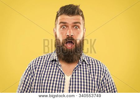 Wondering Every Time. Man Bearded Hipster Wondering Face Yellow Background Close Up. Guy Surprised F