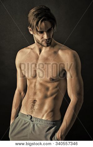 Sportsman With Sexy Torso And Chest. Training And Workout Activity In Gym. Man With Six Pack And Ab