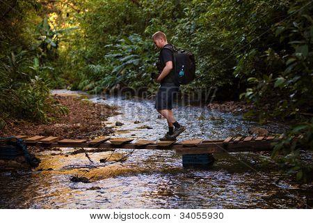 Hiker Crosses Stream