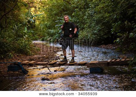 Man Standing  On Footbridge