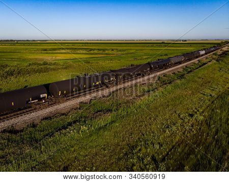 Drone View Of Black Tank Cars On Prairie