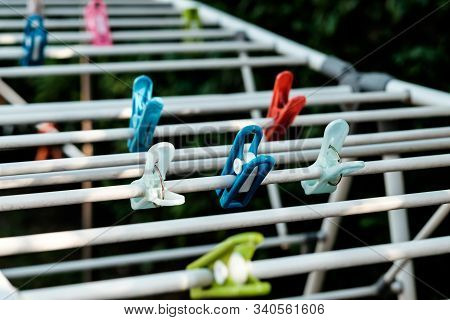Cloth Pegs In Multicolor Attached To The Clothlines