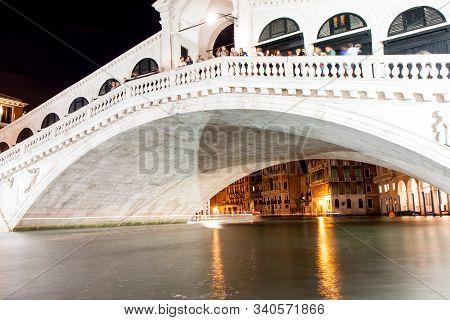 Tourists Line The Rialto Bridge In Venice Italy