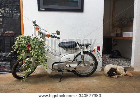 Saigon, Vietnam - Nov 11, 2018. Old Honda Motorbike At The Typical House In Saigon, Vietnam. Saigon
