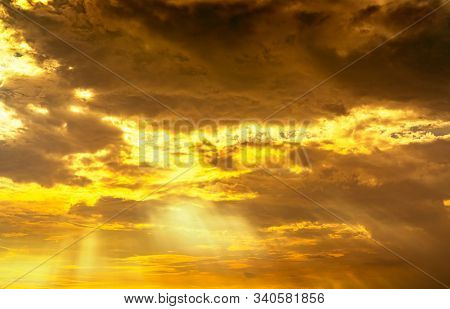 God Light. Dramatic Golden Cloudy Sky With Sun Beam. Yellow Sun Rays Through  Golden Clouds. God Lig