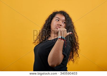 Atractive Afro-american Young Lady With Overweight Over Isolated Orange Background Wearing Fashion B