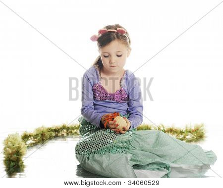 A beautiful little mermaid carefully holding a hermit crab.  On a white background. poster