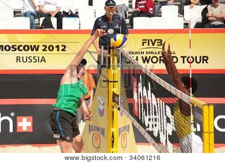 MOSCOW, RUSSIA - JUNE 8: Thiago Santos Barbosa (right) - Ferramenta, Brazil vs Christopher McHugh (left) - Slack, Australia, during Beach Volleyball Swatch World Tour in Moscow, Russia at June 8, 2012