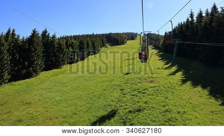Cableway In Summer Above Grassed Green Ski Slope