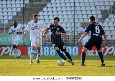 KAPOSVAR, HUNGARY - MAY 27: Tamas Horvath (white 10) in action at a Hungarian National Championship soccer game Kaposvar (white) vs Zalaegerszeg (black) May 27, 2012 in Kaposvar, Hungary.