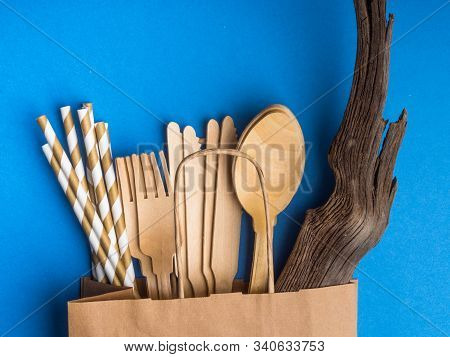 Disposable Wooden Cutlery In Paper Bag On Trendy Blue Color Background, Cutlery, Recycling And Eco F