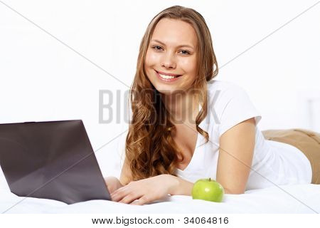 Portrait of a young woman with notebook