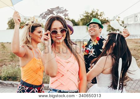 Brazilian Carnival. Brazilian Woman In Costume And Sunglasses Celebrating The Carnival Party In The