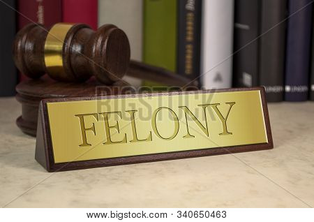 Golden Sign With Gavel And Engraved Word Felony On A Desk