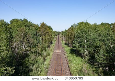 Overhead View Of Empty Tracks Through Green Countryside