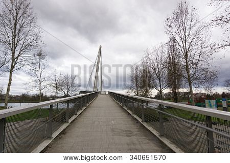 View Of The Passerelle Des Deux Rives Bridge Over The Rhine River Outside Of Strasbourg