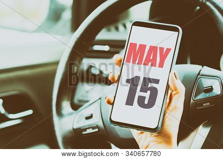 May 15th. Day 15 Of Month, Calendar Date. Month And Day Placed On A Smartphone Screen In Womans Hand