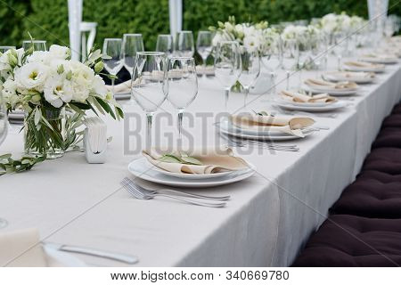 Table Setting With Sparkling Wineglasses And Cutlery In Tent Outdoors, Copy Space. Place Setting At