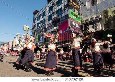 Puli, Taiwan - December 14th, 2019: people parade in Puli carnival at Nantou, Taiwan