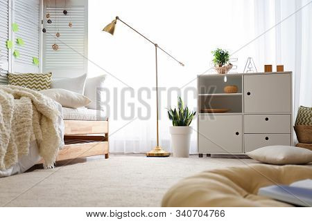Stylish Chest Of Drawers In Bedroom Interior