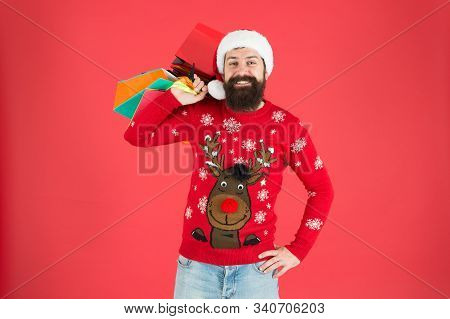 Take It All. Man On Winter Shopping. Guy Wear Knitted Sweater And Hat Carry Shopping Bags. Bearded H