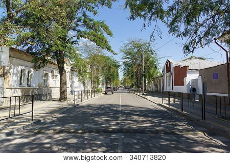 Yevpatoria, Crimea, Russia-september 8, 2019: Bartenev Street In The Resort Town. Sunny Summer Day