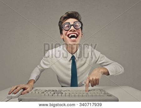 nerd funny businessman at the computer
