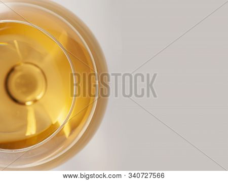 Glass Of White Wine With Shadow With Text Field.. Top View. Abstract Red Wine Bubbles.