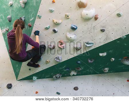 Girl Climbing Bouldering Problem. Rock-climbing Icon. Young Women Climbing In Motion. Climbing Backg