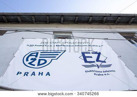 Prague, Czechia - November 6, 2019: Azd Praha & Elektrizace Zeleznic Logo In Front Of One Of Their T