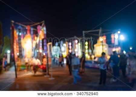 Blurred People And Colorful Blurred Lights In Loi Krathong Festival At Phayao Thailand