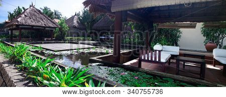 Outdoor Bungalows For Rest And Relaxation On The Ocean. Around The Bungalows Are Pools With Blooming