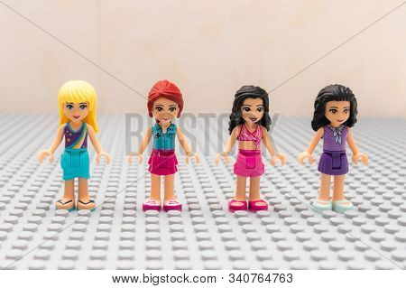 Kouvola, Finland - 18 December 2019: Lego Friends Minifigures Staying On Gray Baseplate