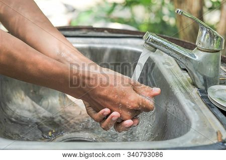 Healthy Park Concept With Washing Hands Close-up Photo. Man Washing Hands In The Park With Water Tap