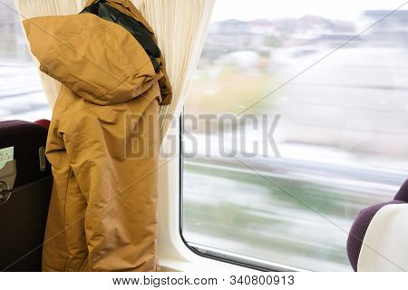 Looking Through Window With Snow Travels On A Train In Hokkaido Japan. Concept Of Travel In Hokkaido