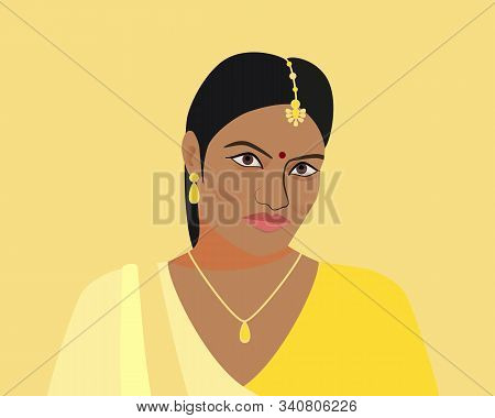 Portrait Of A Beautiful Indian Woman. A Young Hindu Girl In Traditional Clothes And With Golden Jewe