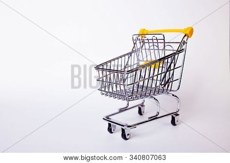 Shopping Cart Concept Of Shopping And Sales, Retail And Shops. Empty Shopping Cart On White Backgrou