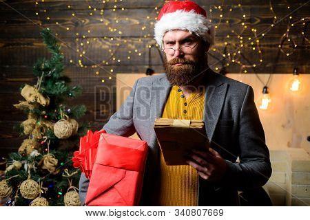 Post For Santa Claus. Letter For Santa Claus. Man Bearded With Eyeglasses Reading Post For Santa. Sp