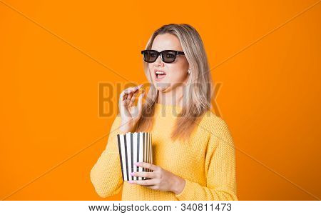 Young Cheerful Woman In 3d Glasses Watching A Blockbuster And Eating Popcorn. Fan Movie Concept On Y