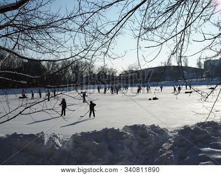 People Skate On The Rink And Play Hockey On A Clear Sunny Frosty Day. Russia, Saratov - December, 20