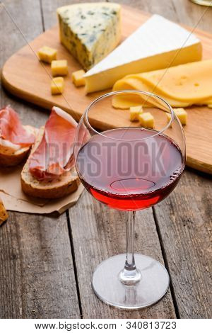 Red Wine, Meat And Cheese. A Glass Of Old Wine In Combination With Sandwiches