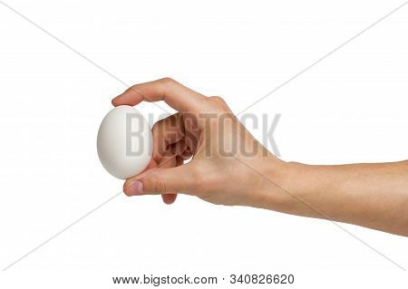 Well Shaped Manicured Mens Hand With An Egg Isolated Over White
