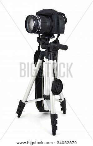 Black digital camera on a tripod